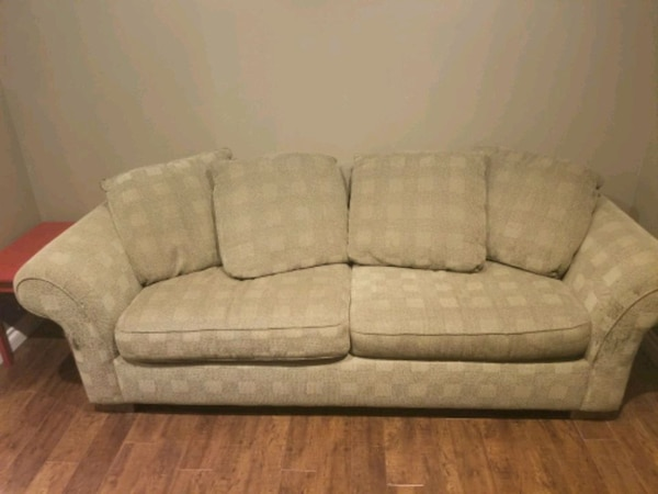 Cloth couch with queen sized hide-a-bed 4fb25eec-42b5-445a-aec5-9655cd301325
