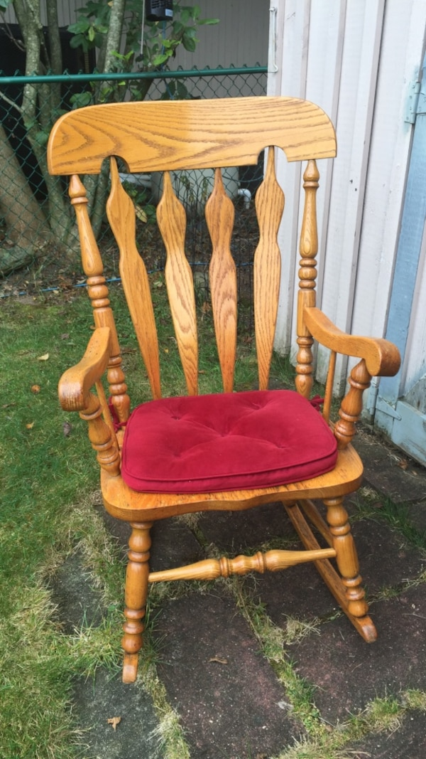 Brown Wooden Rocking Chair With Red Cushion