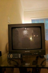 Black CRT TV with remote. Great for gaming!!  Roswell