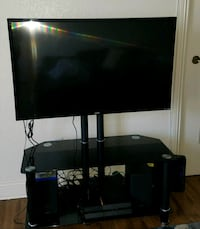 black flat screen TV with black TV stand  Los Angeles, 90045