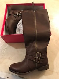 pair of black leather side-zip knee-high riding boots