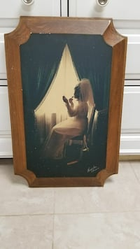 woman getting ready for her wedding painting with brown wooden frame