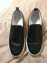 pair of black leather slip-on shoes Atlanta, 30329