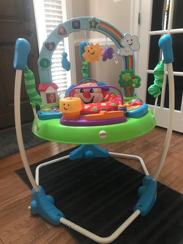 baby's multicolored Fisher-Price bouncer