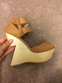 Pair of brown leather wedge sandals Burnaby, V5H 3N7
