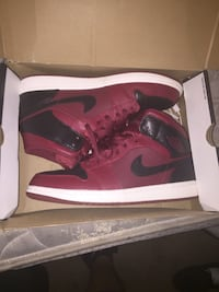 pair of red-and-black Nike basketball shoes Clarksville, 37042
