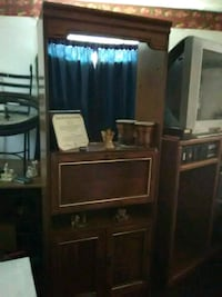 brown wooden TV hutch with flat screen television Port Arthur, 77640