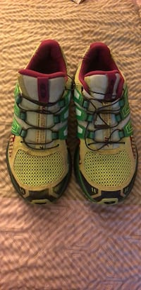 Pair of green-and-black Salomon running shoes 1815 mi
