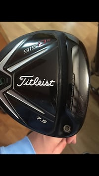 black and gray Titleist golf driver