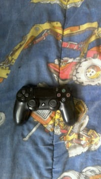 black Sony PS4 game controller London, N5V 4Z8