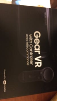 black Samsung Gear VR with controller box