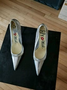 pair of gray leather peep toe pumps
