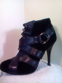 pair of black leather heeled booties Fresno, 93705