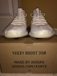 Pair of white adidas yeezy boost 350 on box Sterling, 20165