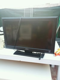 black flat screen TV with remote San Diego, 92113