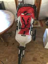 baby's red and white jogging stroller Chesapeake, 23322