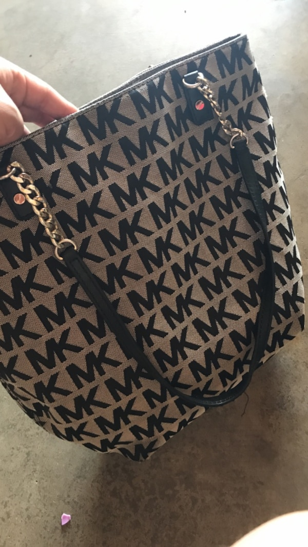 blue and white monogram Michael Kors tote bag