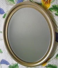Oval  mirror..all wood. Surrey