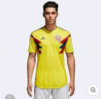 yellow, black, and red Adidas v-neck shirt