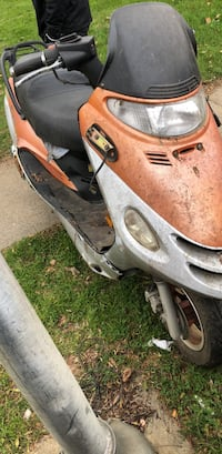 gray and orange motor scooter 25 mi