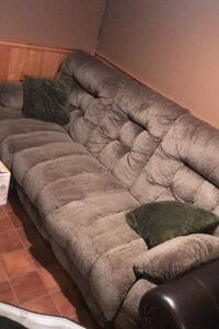3 seated couch, off green/grey in colour Paris, N3L 2E1