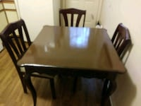 rectangular brown wooden table with six chairs dining set Reidsville, 27320