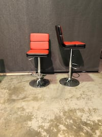 Two red and black leather bar stools Mission, V2V 7R3
