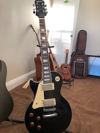 White and black electric guitar 26 mi