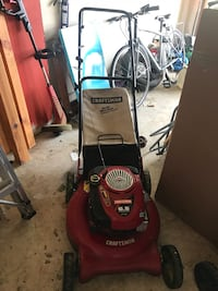 red and black Craftsman push mower Bristow, 20136