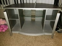 Gray tv stand w/glass shelves, 2 storage cabinets Highland