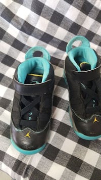 pair of black-and-teal sneakers Little River, 29566