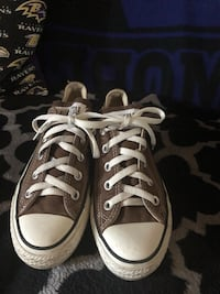 Pair of white converse all star low-top sneakers York