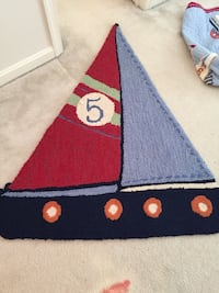 black, blue, and red sailboat rug 16 km