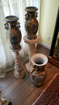 two white-and-brown ceramic vases Montreal, H3R 3L4