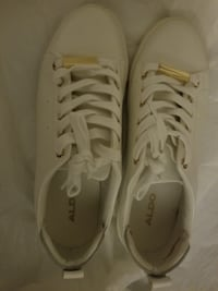 pair of white low-top sneakers New Delhi, 110058