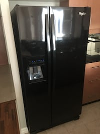 Black side-by-side refrigerator with dispenser Toronto, M4W 3Y2