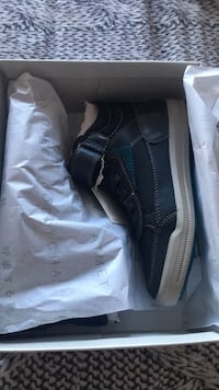 pair of black adidas low-top sneakers with box 719 km