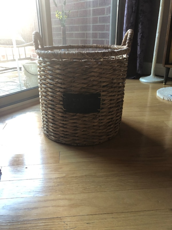 Woven storage basket with chalkboard sign