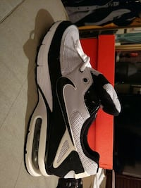 black and gray nike running shoe with box