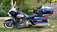 blue and black touring motorcycle Hudson, 03051