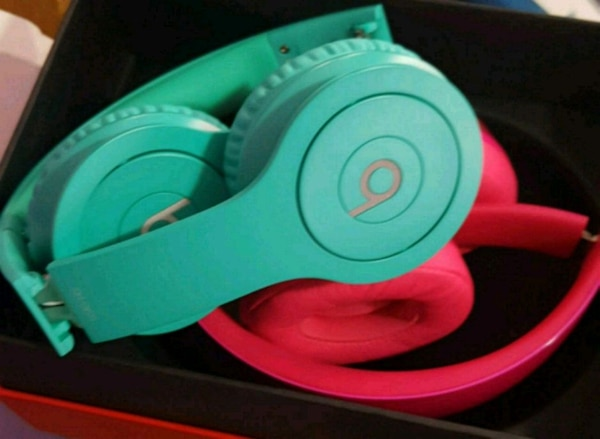 red and green Beats by Dr. Dre headphones with box