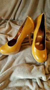 pair of yellow heeled shoes