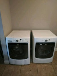 two white front-load clothes washer and dryer