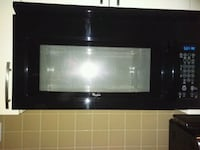 Black microwave over the rent