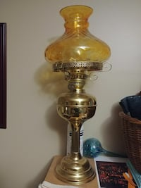 amber glass and brass oil lamp