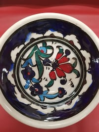 round white and blue floral ceramic plate