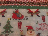 blue and red Christmas print textile