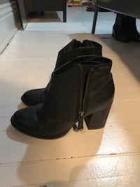 pair of black leather side zip boots Toronto, M6R 1E6