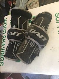 Hockey/lacrosse gloves and elbow pads. Brand new