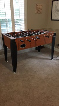 brown and black foosball table Brentwood, 37027